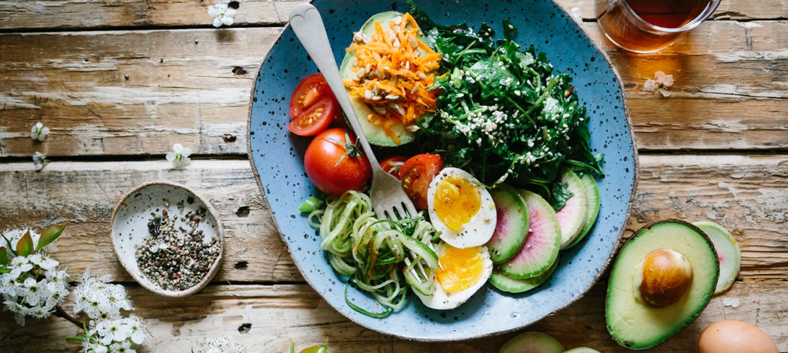 A healthy salad on a wooden table